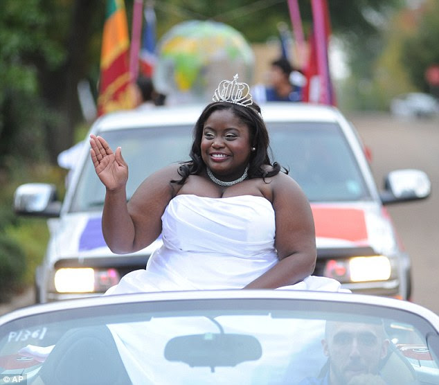 Unique: Courtney Pearson, the first ever African-American homecoming queen at the University of Mississippi, rides in the homecoming parade in Oxford, Miss. on Friday, Oct. 12