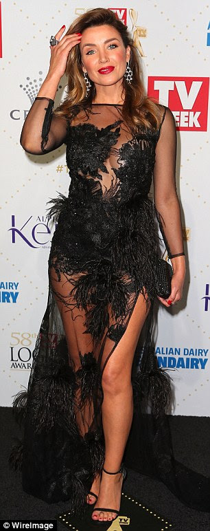 Leggy display:The younger sister of pop icon Kylie was all the more eye-catching thanks to the daring thigh high slash that fully revealed her left leg
