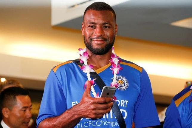 Leicester City's player Wes Morgan gestures as he arrives with his team at Suvarnabhumi International Airport, in Bangkok, Thailand, May 18, 2016. REUTERS/Athit Perawongmetha/Files