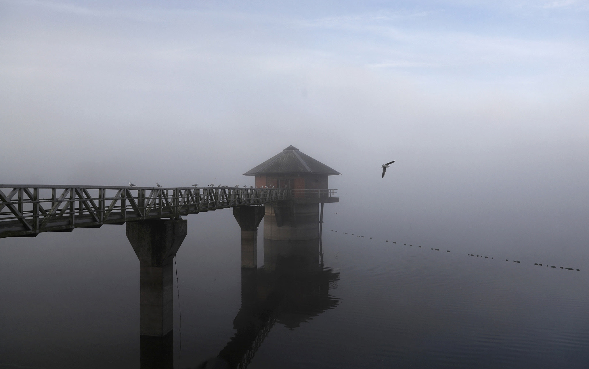 Morning mist sits over the Cropston Reservoir in Britain, October 3, 2016.   REUTERS/Darren Staples TPX IMAGES OF THE DAY