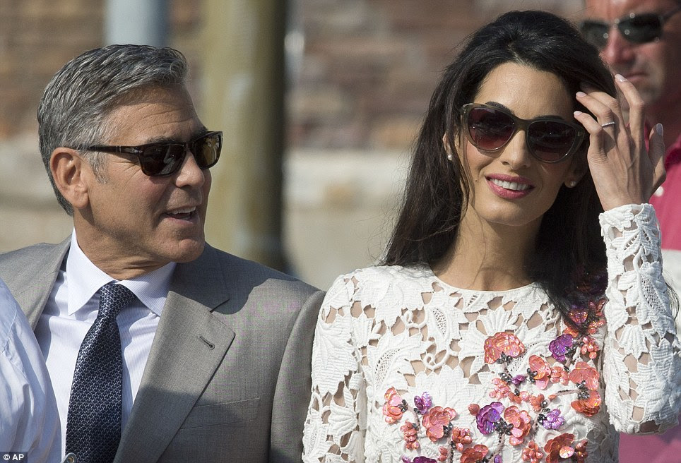 Specs appeal... The dazzling duo both sported chic sunglasses, while Amal accessorised her look with an elegant pair of pearl earrings