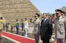 Egypt's President Mursi visits the tomb of ex-President al-Sadat and the Tomb of the Unknown Soldier during the commemoration of Sinai Liberation Day in Cairo