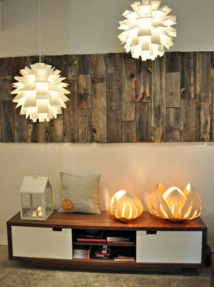 Our wall of wood highlights our Norm 69 lights, Gus Modern's Media cabinet along with our own TUCK pillow and lights by Atellier Cocotte (Isabelle Augere) www.tuckstudio.ca