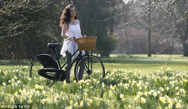 Riding out: Rachael Foister enjoys the hot weather and spring daffodils at West Dean College, West Sussex
