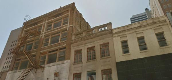 Dallas-based developer Scott Remphrey of Brytar says he plans to preserve the historical integrity of these three Elm Street buildings as he moves forward with a redevelopment project that will bring lofts and retail space to the city's central business district.