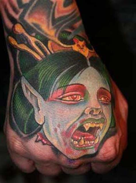 cartoon colored hand tattoo vampire woman face