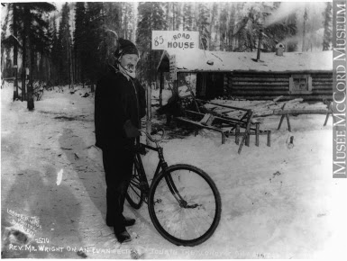 Photograph   Rev. Wright touring the Klondike on bicycle, at 85 Road House, Klondike, YT, about 1898   MP-0000.2360.78