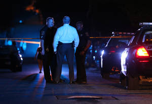 Photo - DeKalb County police officers work at the scene where an Atlanta-based officer was shot Monday evening, Aug. 31, 2015, five miles from Atlanta. DeKalb County police spokeswoman Mekka Parrish did not immediately have any details about the circumstances of the shooting. (Ben Gray/Atlanta Journal-Constitution via AP) MARIETTA DAILY OUT; GWINNETT DAILY POST OUT; LOCAL TELEVISION OUT; WXIA-TV OUT; WGCL-TV OUT; MANDATORY CREDIT