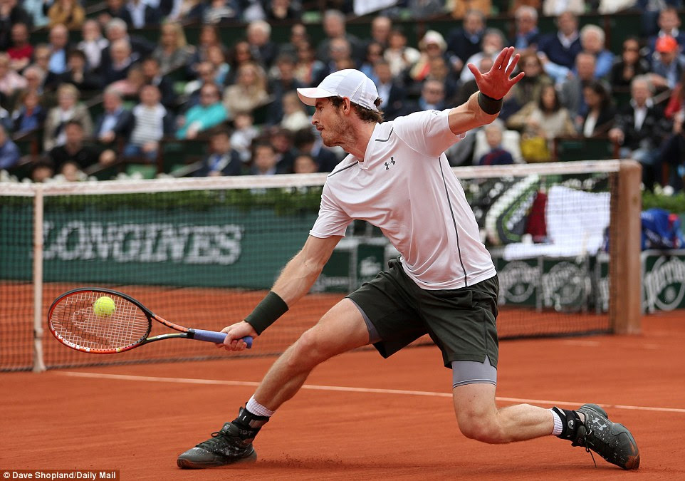 Murray stretches to make a backhand during his clash against rival Djokovic in the final of the French Open