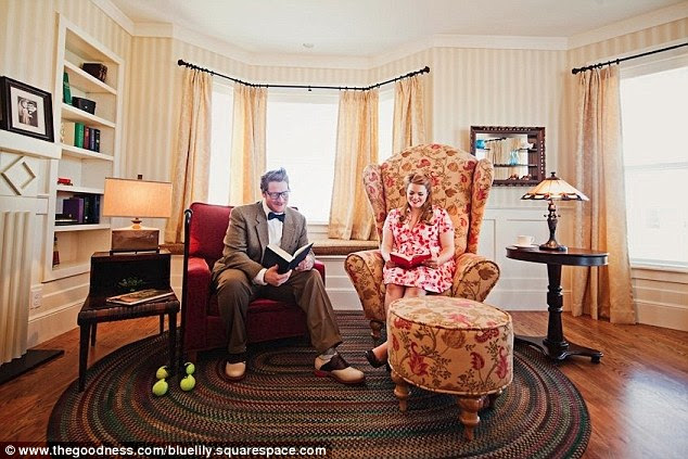 Relaxing: Lisa and Geoff lounge together in the living room, where furniture was replicated to match the film