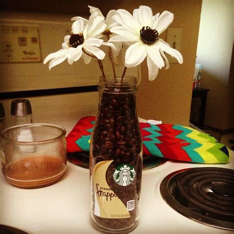Starbucks bottle with coffee beans with some simple