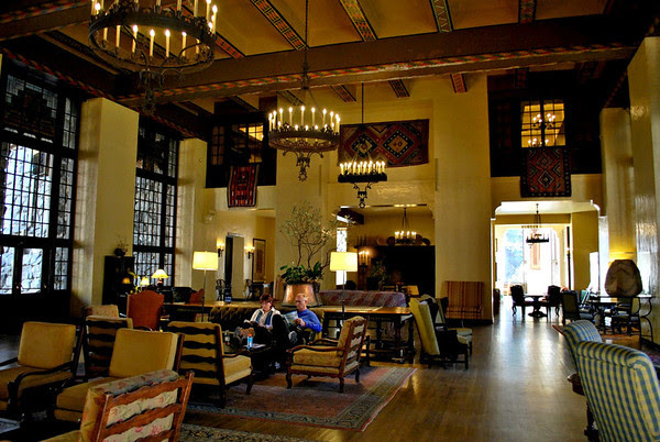 Guests relaxing in the Great Lounge at the Ahwahnee Hotel