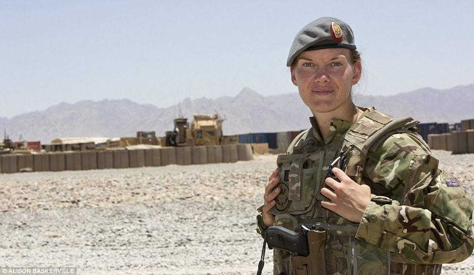 Ready for action: Captain Crossley, a nurse at UCL hosptial on a six-month tour in Afghanistan, stands in full military gear against a backdrop of mountains