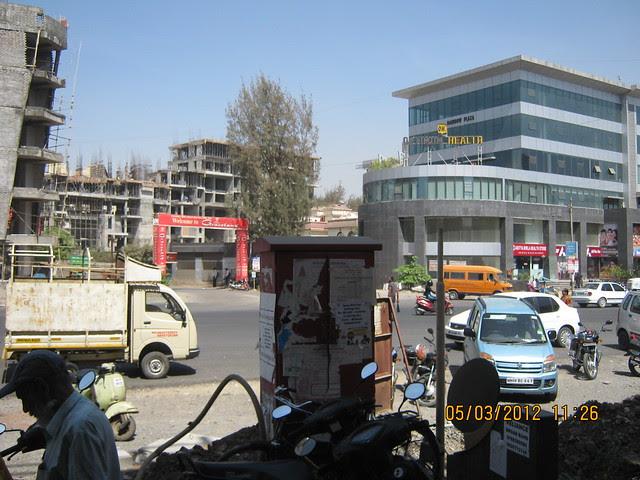 Shivar Chowk on Rahatani Road, Rainbow Plaza & way to Suhas Mantri Constructions' Mystica 3 BHK Flats behind Shivar Garden Hotel Rahatani Pune 411017