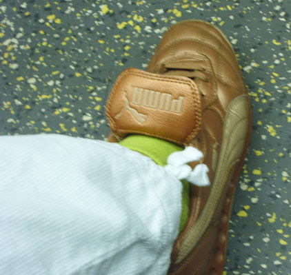 Gold Puma Trainers & Green Socks