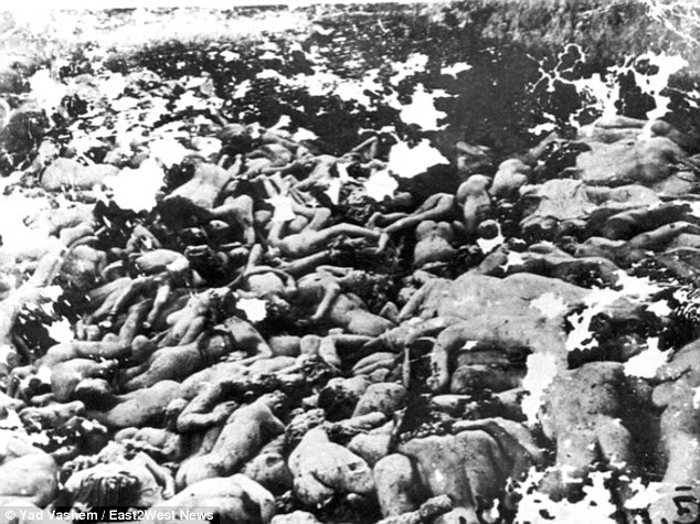 Atrocity: Sometimes the Nazis would make the Jews dig the pits before they shot them to death - and many of the victims were buried in unmarked plots (pictured)