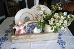china & flowers in toolbox