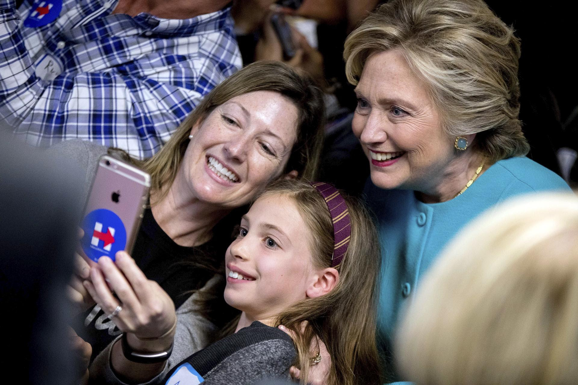 Clinton took a photograph with supporters at a campaign office in Seattle.