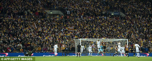Loyal: Phil Parkinson looks on as Bradford City fans continue to show their support despite being dominated
