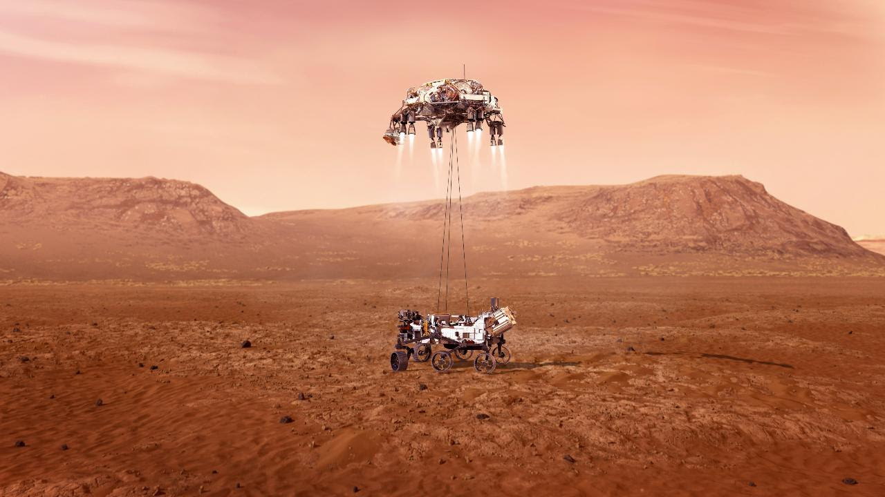 Perseverance rover being placed on Martian soil by the skycrane Image credit: NASA/JPL-Caltech