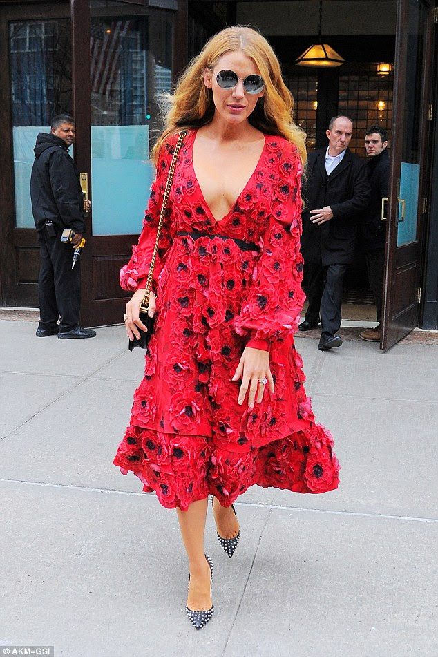 Ravishing in red: Blake Lively may have stopped traffic as she emerged for a second time on Wednesday in a red petal embellished dress