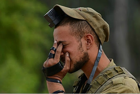 Israeli soldier reciting the Shema prayer near the border in Southern Israel on July 20, 2014.