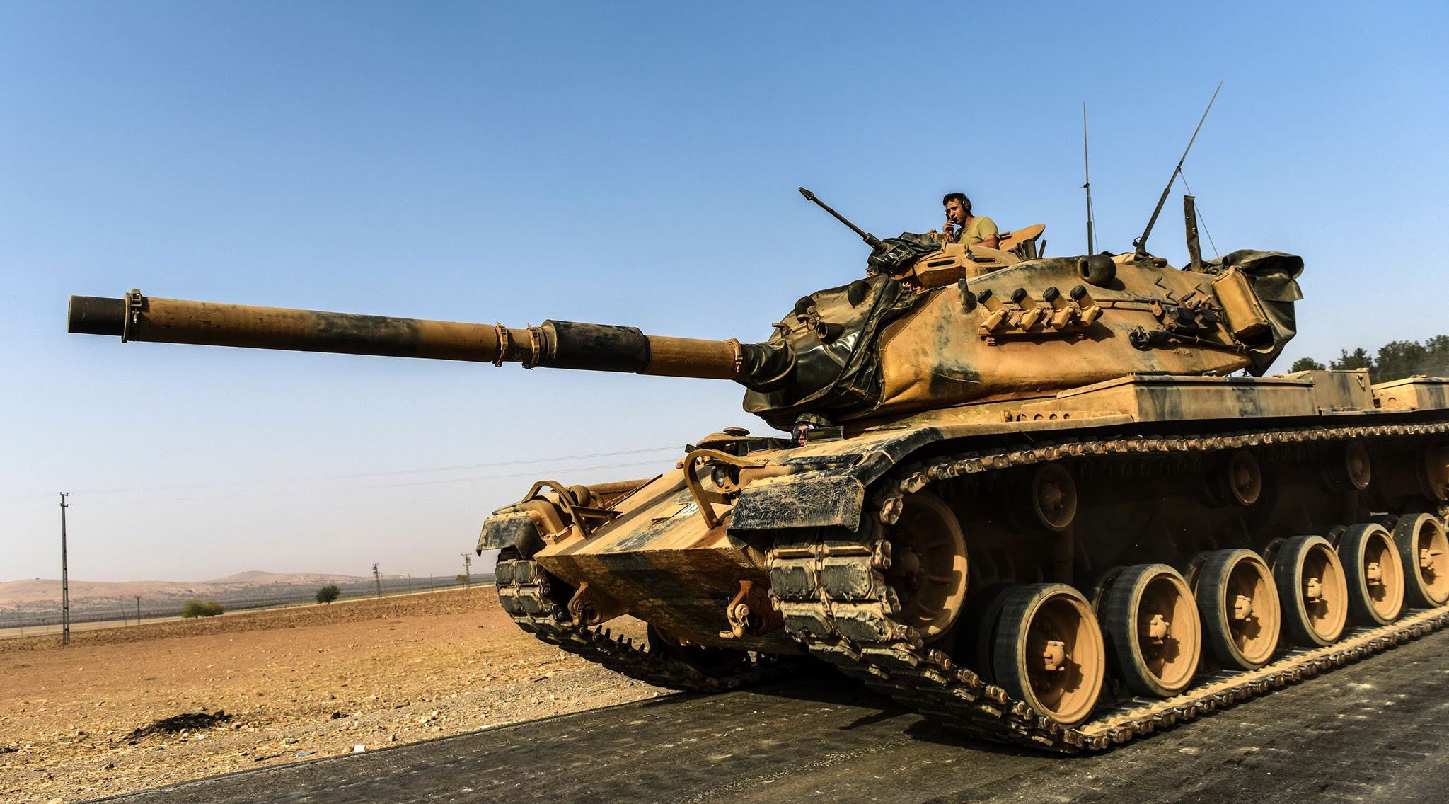 A Turkish army tank drives towards Syria in the Turkish border city of Karkamis, in the southern region of Gaziantep on August 24, 2016. Turkey's army backed by international coalition air strikes launched an operation involving fighter jets and elite ground troops to drive Islamic State jihadists out of a key Syrian border town. / AFP PHOTO / BULENT KILICBULENT KILIC/AFP/Getty Images