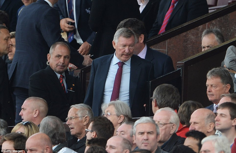 Missing: Sir Alex Ferguson was missing from the team photo after his retirement