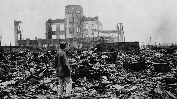 A man looks over the expanse of ruins left the explosion of the atomic bomb on August 6, 1945 in Hiroshima, Japan. Some 140,000 people died here immediately.
