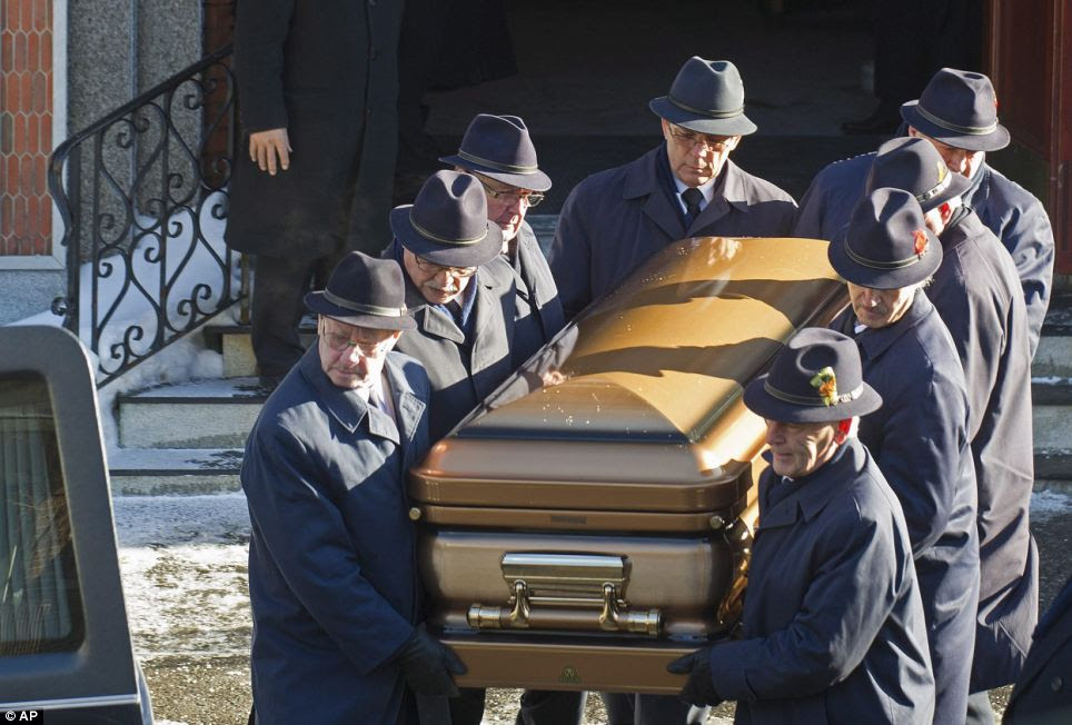 The body of Montreal Mafia boss Vito Rizzuto is carried from the church following his funeral, in a gold casket
