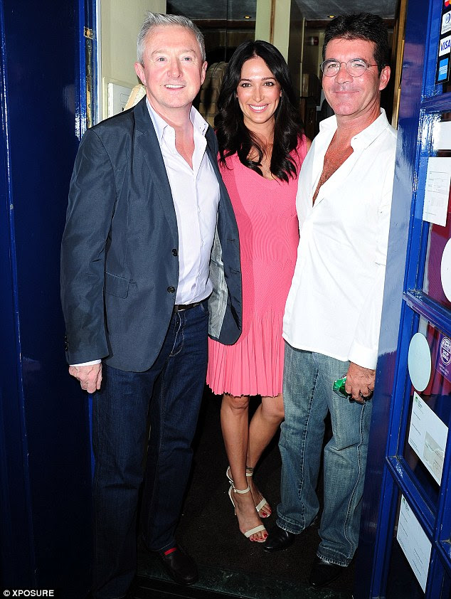 No hiding: Simon Cowell, Lauren Silverman and Louis Walsh arrive at Scalini restaurant in Chelsea on Wednesday night
