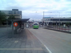 Platform 4 of the Belconnen Community Bus Station, looking west. The white lattice steel pedistrian bridge which repalced a previous concrete one, when the Belconnen Bus Interchange was demolished, is visible.