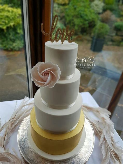 Four Tier Ivory, Blush and Gold Wedding Cake by White Rose