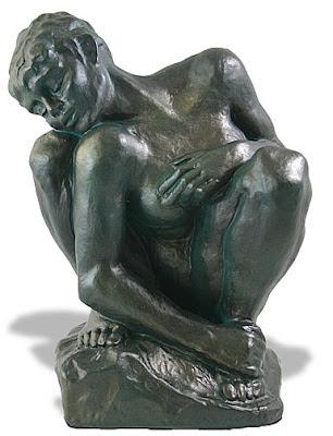 Rodin-crouched woman