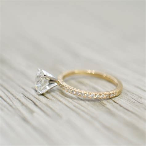 Round Diamond in a Petite French Pavé Engagement Ring in