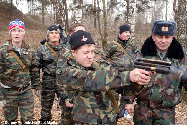 Old enough to hold a gun: Military sports club, 'Berkut', (meaning golden eagle), trains up young Russian, who dream of joining the elite units of the Russian army and fighting under the command of President Vladimir Putin