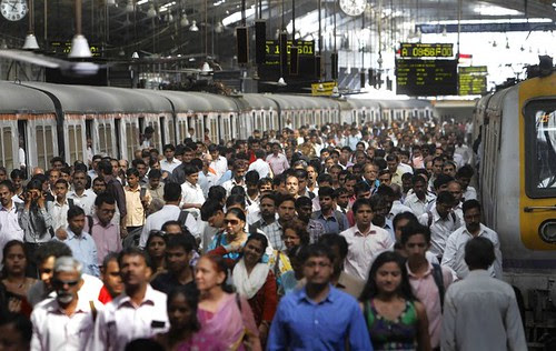 Commuters alight from local suburban trains at a Church gate station in Mumbai, India. Nearly 7 million commuters use the overtaxed suburban rail network each workday in Mumbai. by Pan-African News Wire File Photos