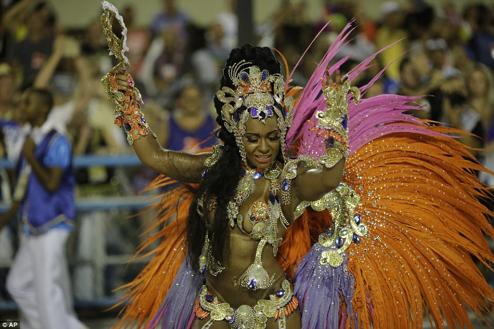 Drum queen Rayssa Oliveira, from Beija Flor samba school, dances during the culmination of the massive Carnival parade in Brazil