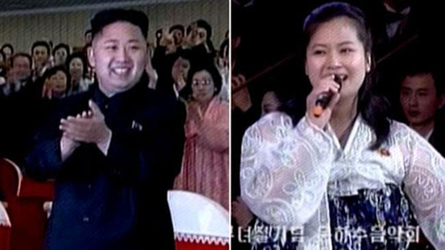 North Korean Leader Kim Jong-un and, right, Hyun Song-wol sings during a concert in Pyongyang. Picture: Supplied