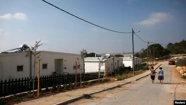 "Israeli women walk in a Jewish settlement known as ""Gevaot"" - in the Etzion settlement bloc - near Bethlehem, Aug. 31, 2014."