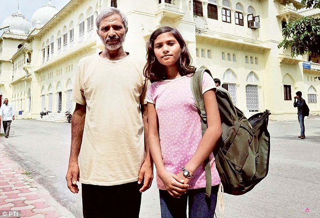 Bright future: Sushma Verma (right) with her father Tej Bahadur (left) at Lucknow University where she is pursuing an MSc in Biotechnology