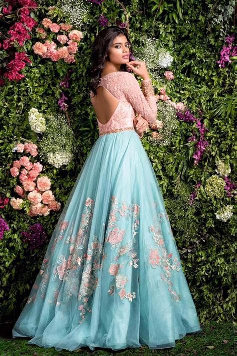 A blush pink and blue gown with thread work and hints of