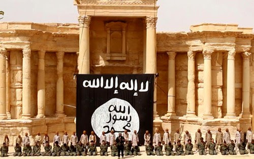 ISIS children conducting executions of 25 Syrian soldiers in ancient Palmyra, in July 2015. (AFP)