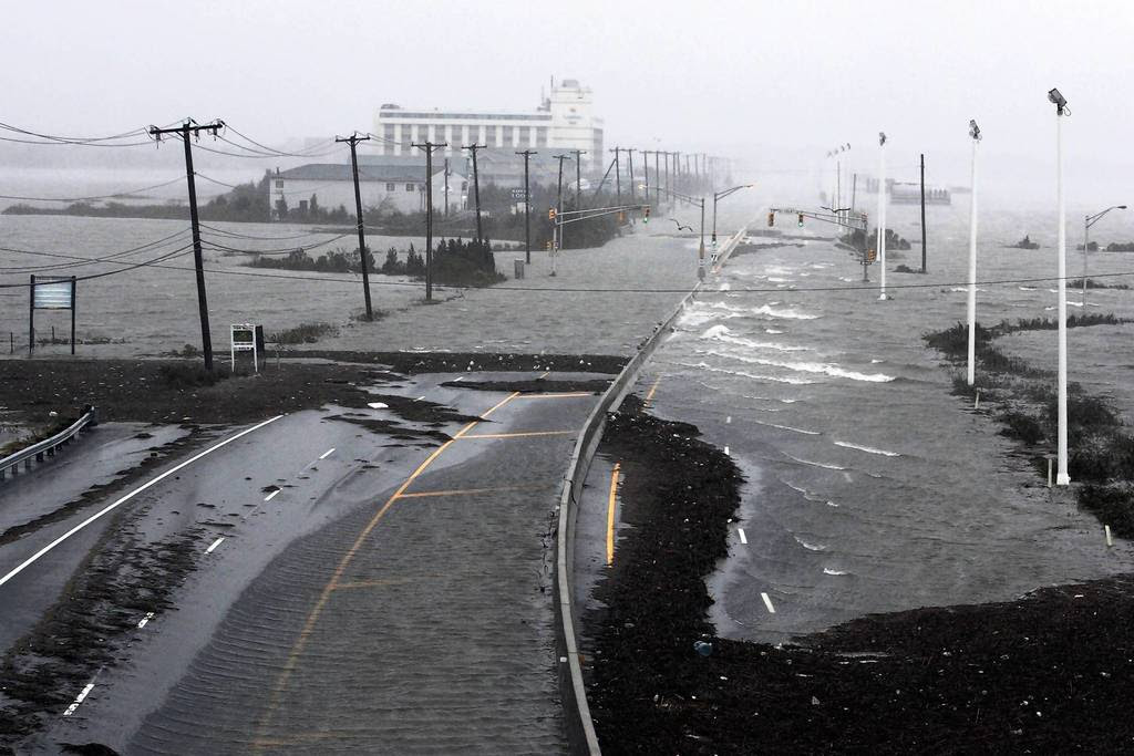 U.S. Route 30, the White Horse Pike, one of three major approaches to Atlantic City, New Jersey, is covered with water from Absecon Bay in this view looking west, during the approach of Hurricane Sandy. Hurricane Sandy began battering the U.S. East Coast on Monday with fierce winds and driving rain, as the monster storm shut down transportation, shuttered businesses and sent thousands scrambling for higher ground hours before the worst was due to strike.