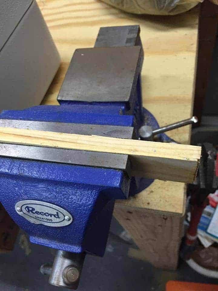 Cut your wood for the drawer stoppers using a vice to hold it.