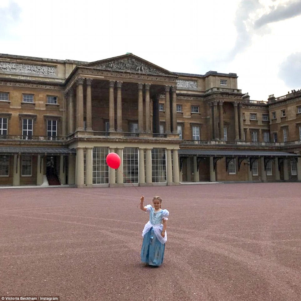 That's some party venue: Harper Beckham got the royal treatment in a fairytale Elsa gown as she attended a tea party at Buckingham palace last week - her parents shared the snaps on Instagram on Monay as they wished her a happy sixth birthday