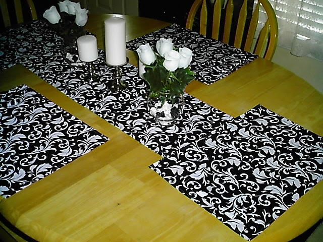 Table runner,place mats,napkins,4piece set.  Matching place mats and napkins