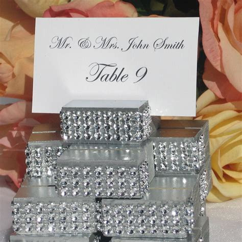 Silver Place Card Holder trimmed with a rhinestone wrap