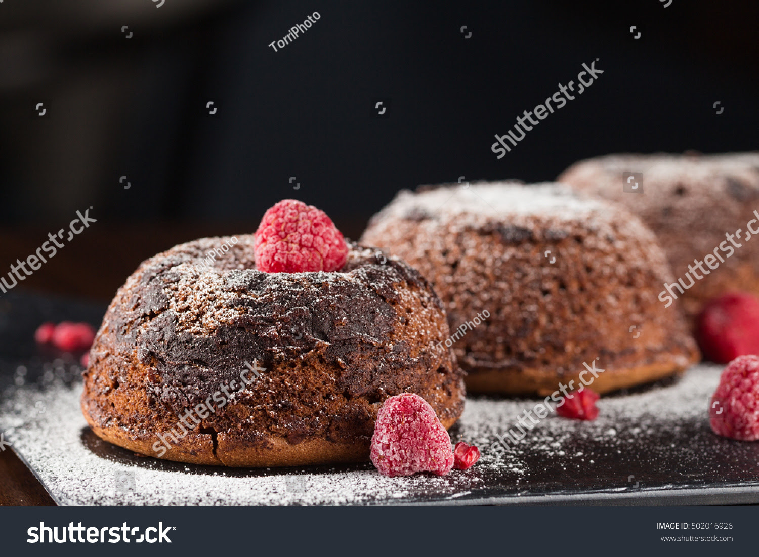 http://www.shutterstock.com/pic-502016926/stock-photo-chocolate-fondant-cake-with-raspberries-on-dark-background-shallow-focus.html
