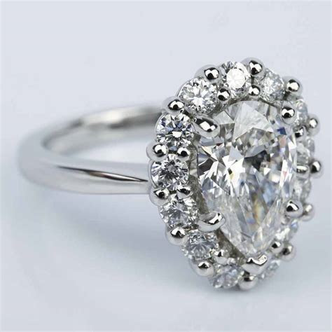 floral halo engagement ring  pear cut diamond  ct
